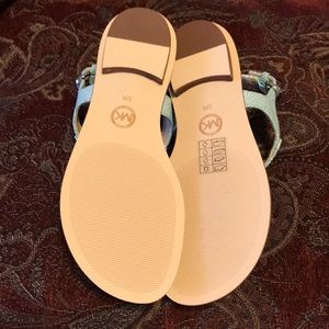 f45af9ef06b3 MICHAEL Michael Kors Shoes - MICHAEL Michael Kors Plate Leather Thong  Sandals